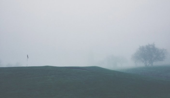 golf course in the fog